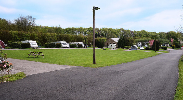 Pitches Overlooking the Play Area at Lickpenny Caravan Park